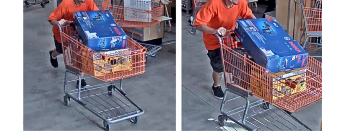 Man pushing shopping cart filled with hammer and drill sets
