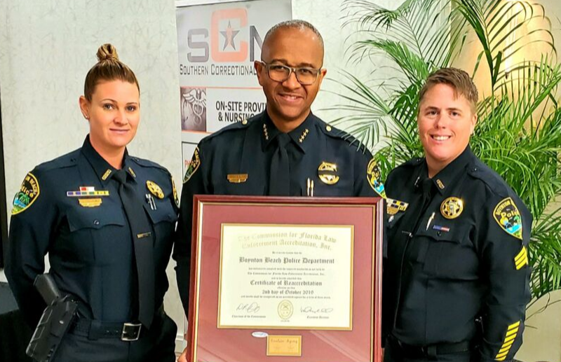 Chief Gregory holding framed certificate