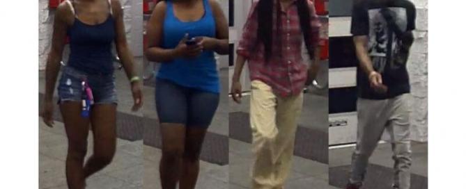 four people walking into walmart