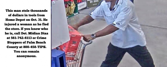 Black man in white shirt pushing shopping cart at Home Depot