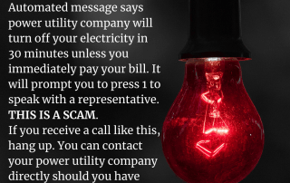 scam alert notice of text next a red light bulb that is on.